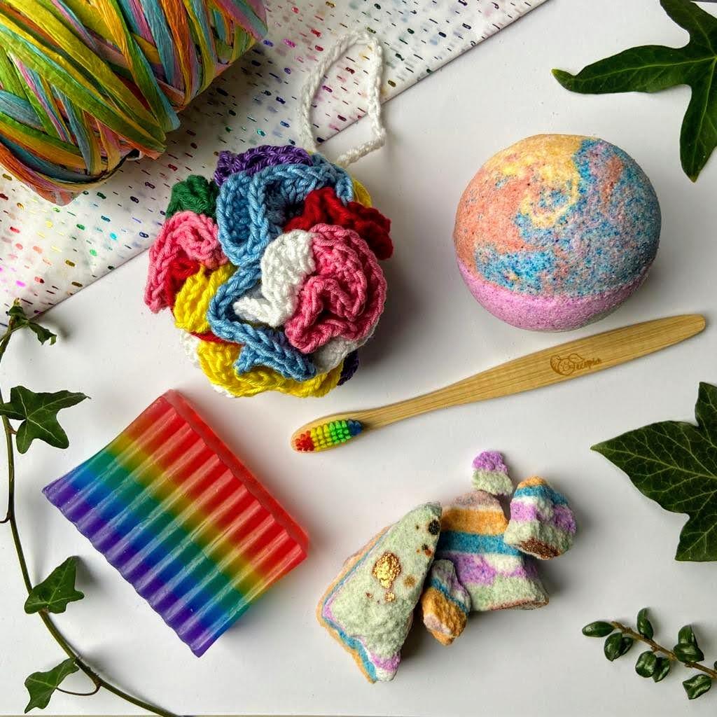 Rainbow box of joy sustainable handmade gift box with soap, bath bomb, bath pouf, bath bomb rocks and rainbow toothbrush